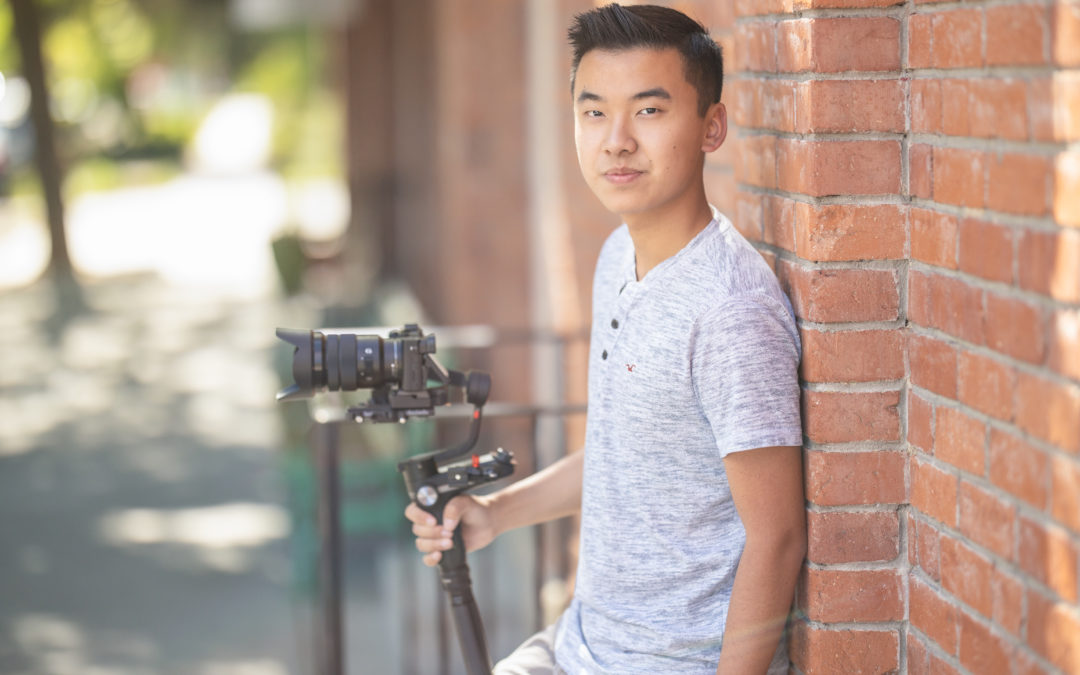 Young man with camera and video equipment