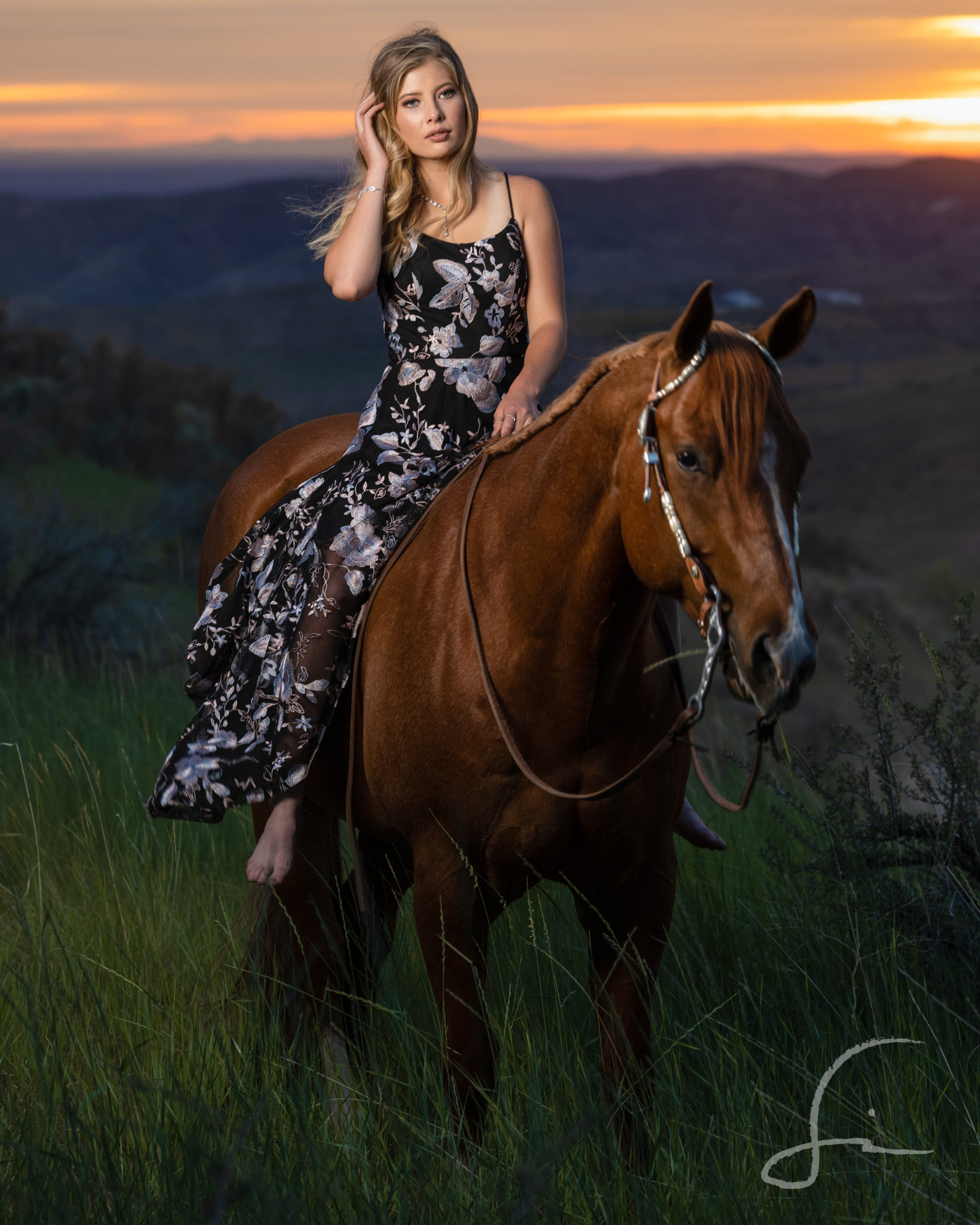 teen girl on her horse in a field at sunset