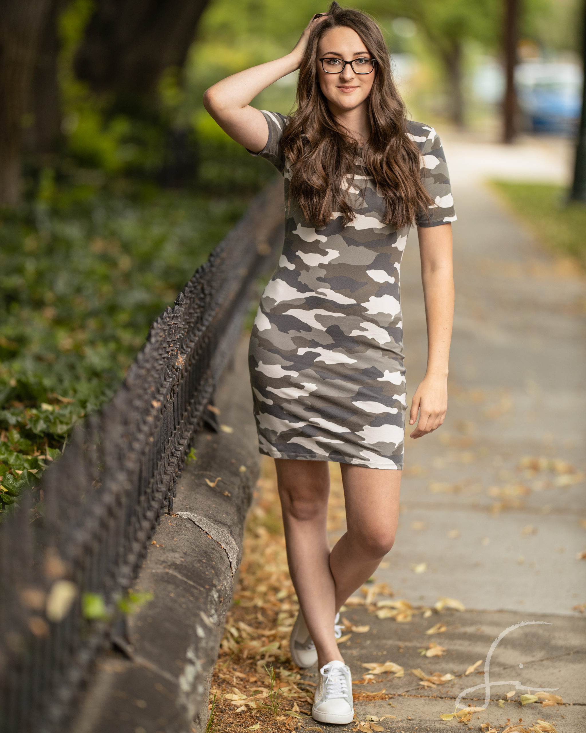 teen girl in a camouflage knit dress