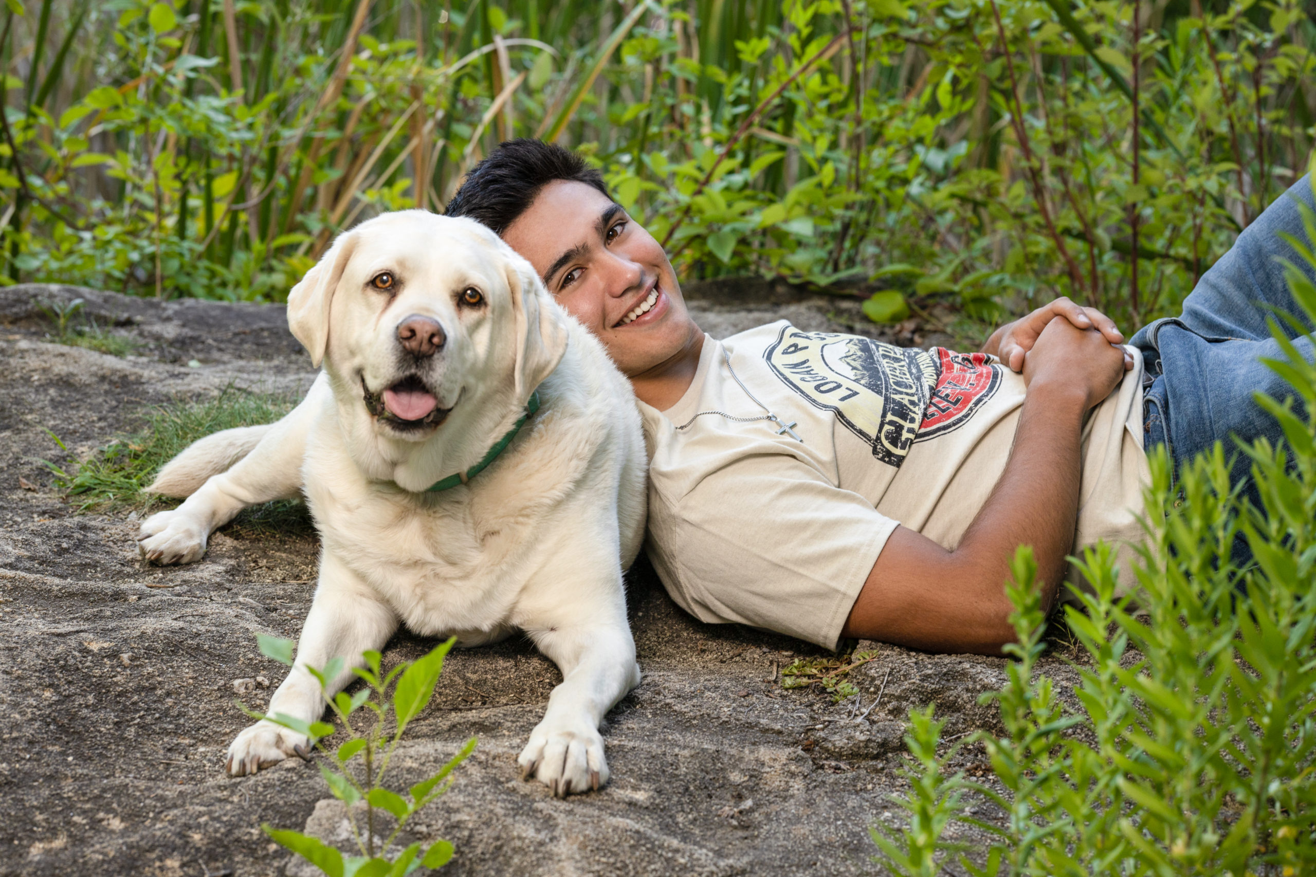 teen boy with his white lab