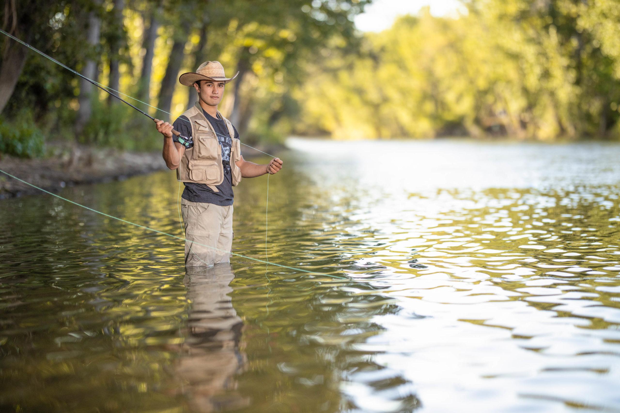 senior boy fly fishing in the Boise River in Idaho