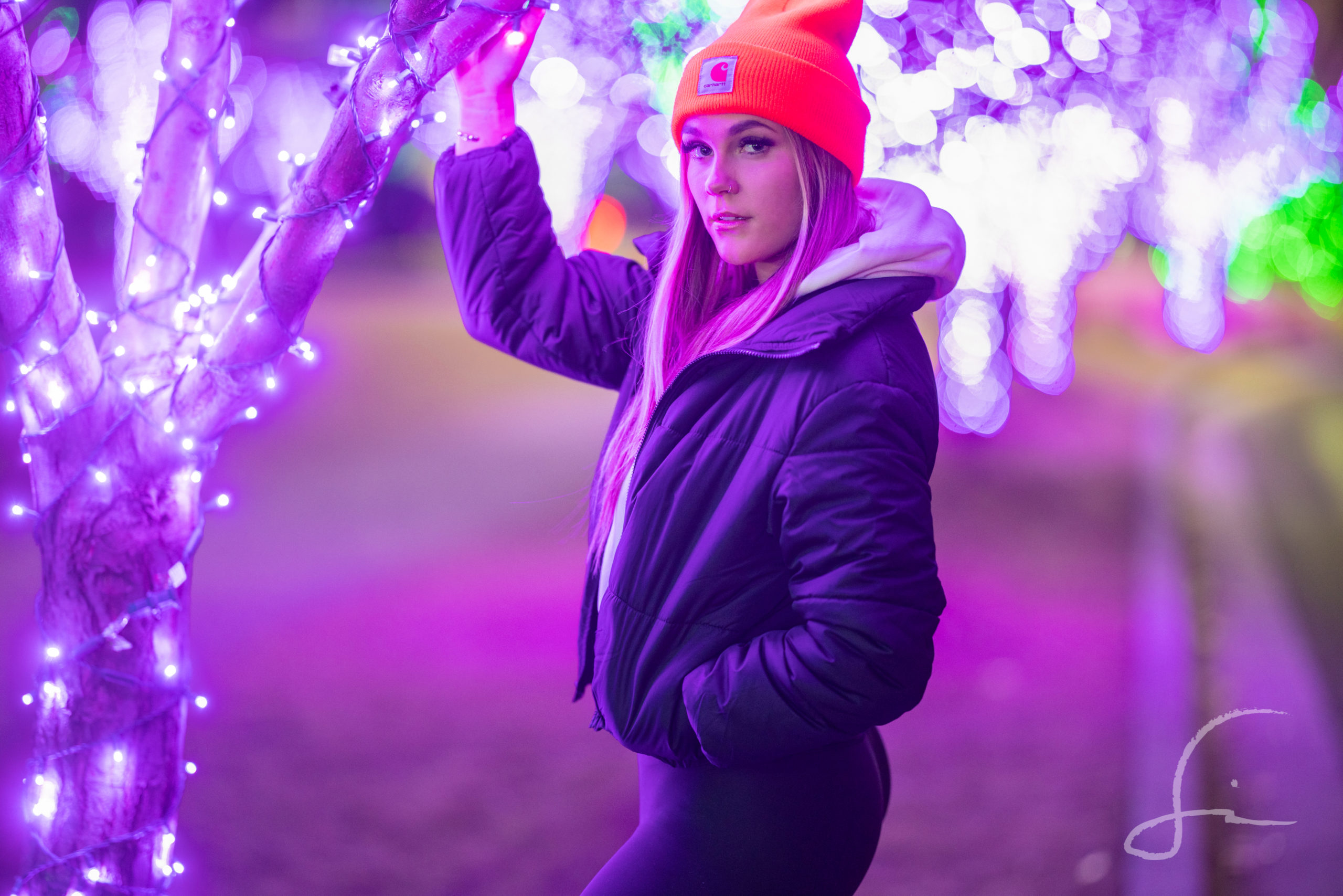 High School Senior in a grove of lighted Christmas Trees