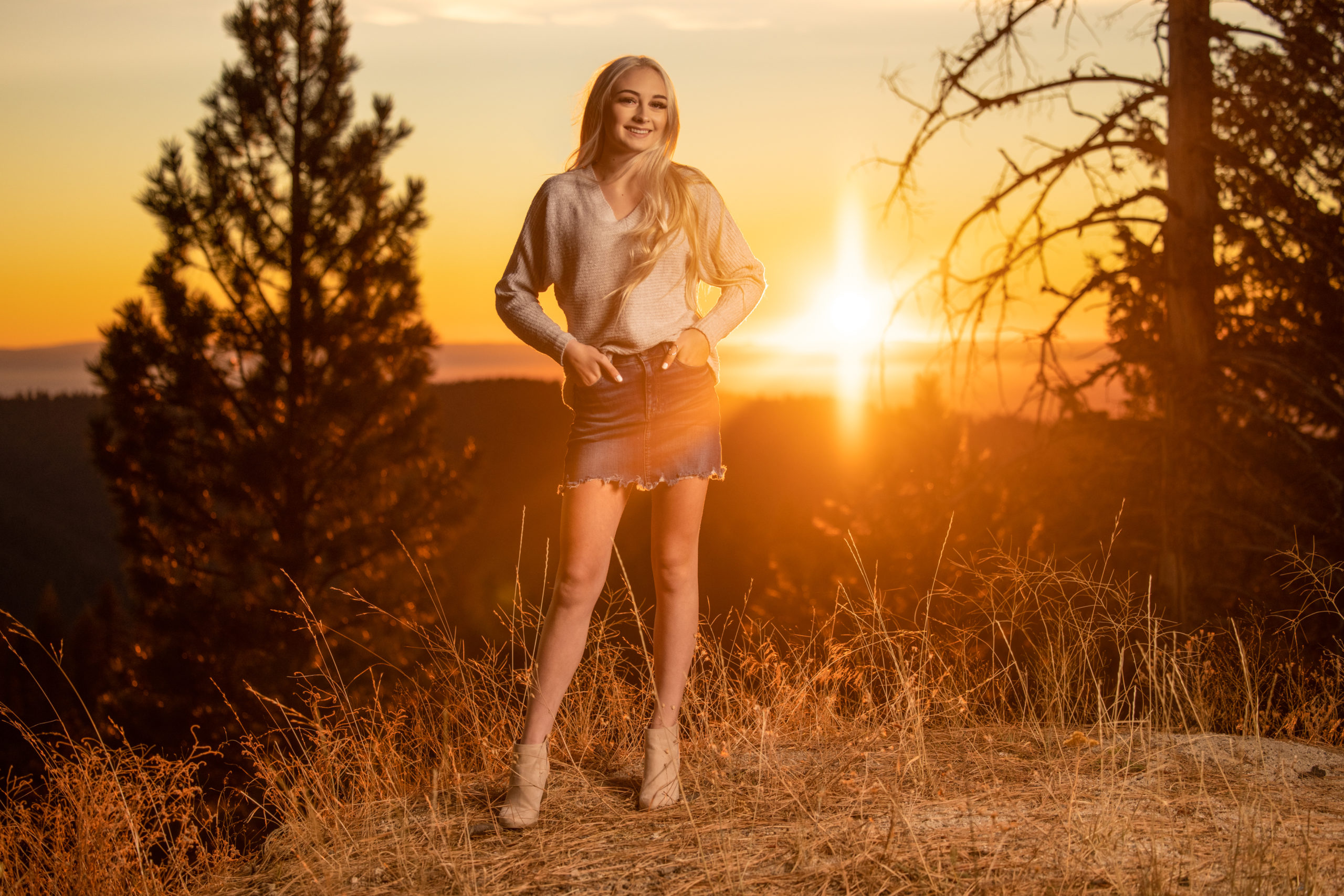 high school teen girl in the mountains at sunset