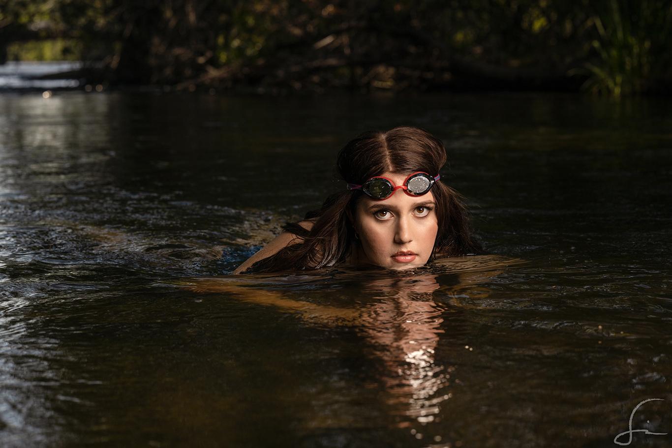 high school senior swimmer in the Boise River for her senior Portraits by Samuel Marvin Photography